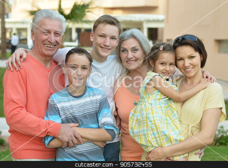 happy family at resort stock photo, Portrait of happy smiling family at resort by Ruslan Huzau
