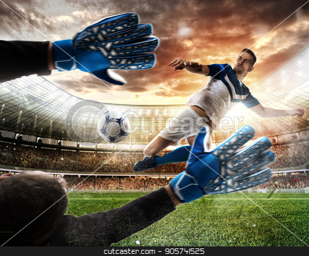 Goalkeeper catches the ball in the stadium stock photo, Goalkeeper catches the ball in the stadium during a football game by Federico Caputo
