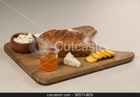 Variety of cheese with bread and sauce on chopping board against white background stock photo, Variety of cheese with bread and sauce on chopping board against white background by Wavebreak Media