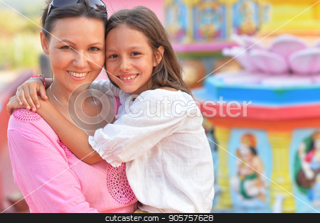 Happy mother and daughter   stock photo, Happy mother and daughter posing on blurred amusement park background by Ruslan Huzau