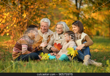 Big family having fun  stock photo, Big family having fun in autumnal park by Ruslan Huzau