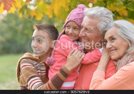 happy grandparents and grandchildren stock photo, Family portrait of happy grandparents and grandchildren by Ruslan Huzau