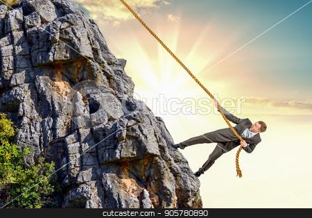 Businessman climb a mountain stock photo, Businessman climb a mountain. Achievement business goal concept by cherezoff