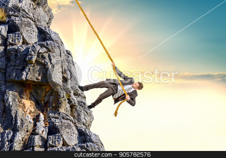 Businessman climb a mountain stock photo, Businessman climb a mountain. Achievement business goal concept by cherezoff