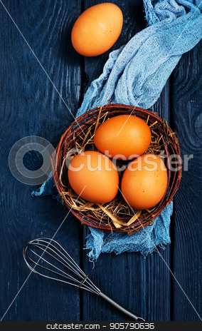 raw chicken eggs stock photo, raw chicken eggs in nest and on a table by tycoon