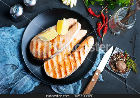 salmon stock photo, raw salmon with spice on a table by tycoon