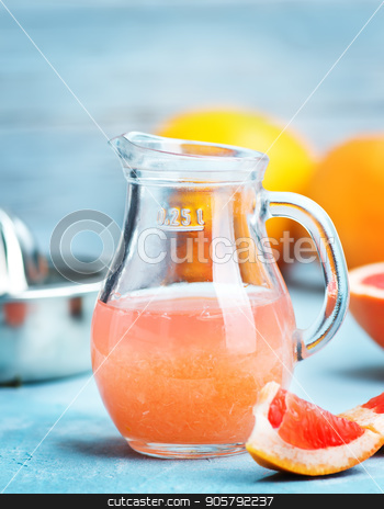 grapefruit and juice stock photo, juice and  fresh grapefruit on a table by tycoon