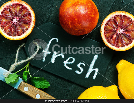 citrus stock photo, citrus background, fresh citrus fruit on a table by tycoon