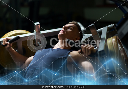 man doing chest press on exercise machine in gym stock photo, sport, fitness, bodybuilding and people concept - man doing chest press on exercise machine in gym by Syda Productions