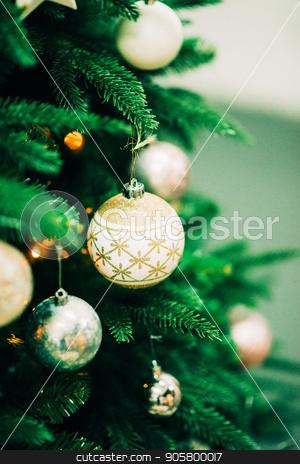 Closeup of Green Christmas tree and pink ball decorations stock photo, Closeup of Green Christmas tree and ball decorations by Alexandra Malyck