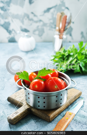 fresh tomato  stock photo, fresh tomato with salt and basil on the kitchen table by tycoon