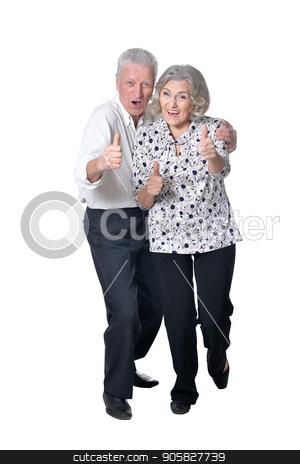 Senior couple showing thumbs up stock photo, Senior couple smiling with thumbs up isolated  on white background by Ruslan Huzau