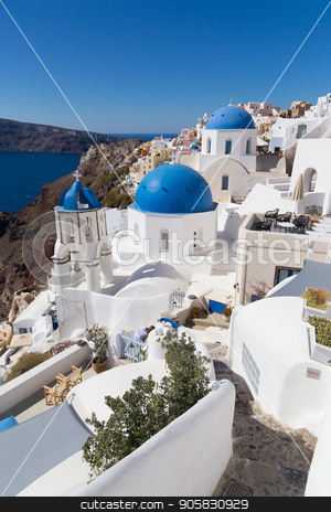 Traditional greek village of Oia, Santorini island, Greece. stock photo, Cityscape of Oia, traditional greek village with blue domes of churches, Santorini island, Greece. by kasto