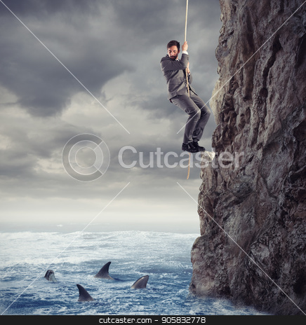 Businessman is likely to fall into the sea with sharks. concept of problems and difficulty in business stock photo, Businessman is likely to fall into the deep sea with sharks. concept of problems and difficulty in business by Federico Caputo
