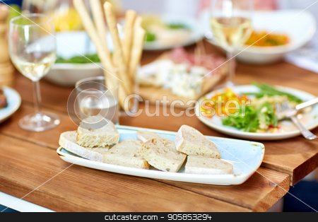 white bread slices on plate stock photo, food, junk-food and unhealthy eating concept - white bread slices on plate by Syda Productions