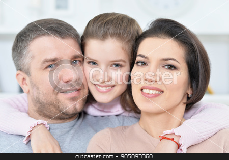 Close up portrait of cute little girl with her parents  stock photo, Close up portrait of cute little girl with her parents  posing by Ruslan Huzau