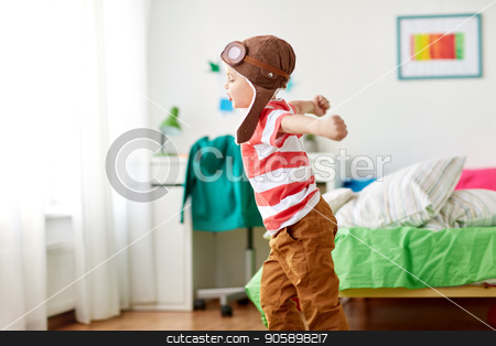 9634419f happy little boy in pilot hat playing at home stock photo