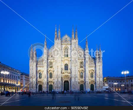 MILAN, ITALY - APRIL 28th, 2018: turists during blue hour taking pictures in Duomo Square , the main landmark of the city. stock photo, Milan's spacious city square, the Piazza del Duomo, is named for the huge church that overlooks it. Today, the piazza is a central meeting place, home to many of the city's significant buildings. by Paolo Gallo