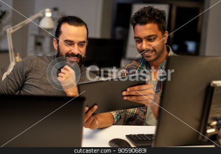 creative team with tablet pc working at office stock photo, deadline, technology and people concept - creative team with tablet pc computer working together late at night office by Syda Productions