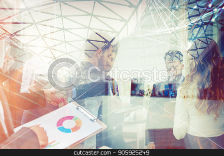 Handshaking business person in office. concept of teamwork and partnership. double exposure stock photo, Business people working together in office with internet network effects. Concept of teamwork and partnership. double exposure by Federico Caputo