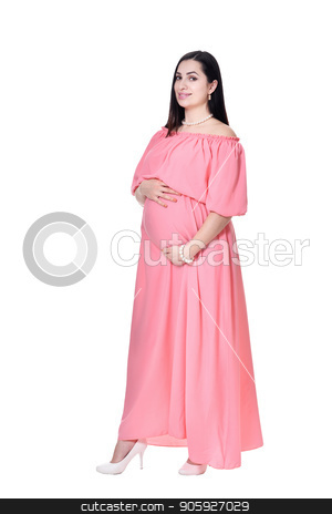 c3aaad0f74ba5 Beautiful pregnant woman in pink dress stock photo