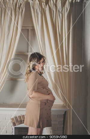a pregnant woman holding hands on belly stock photo, a pregnant woman holding hands on belly by aaalll3110
