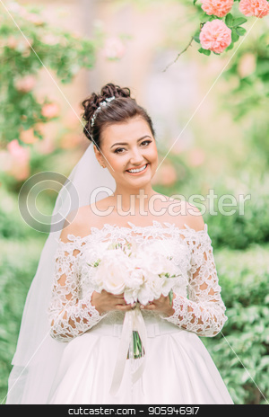 Close-up outdoor portrait of the cheerful bride with the wedding bouquet. stock photo, Close-up outdoor portrait of the cheerful bride with the wedding bouquet by Andrii Kobryn