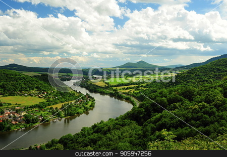 The river running through countryside stock photo, The river running through woodlands and villages in summer by Ondrej Vladyka