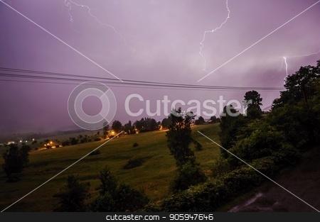 Summer storm in the night landscape stock photo, Summer storm in the night landscape with trees by Ondrej Vladyka