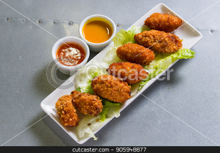 Close up shot of chicken wings stock photo, Close up shot of brown crispy chicken wings by Shane Maritch