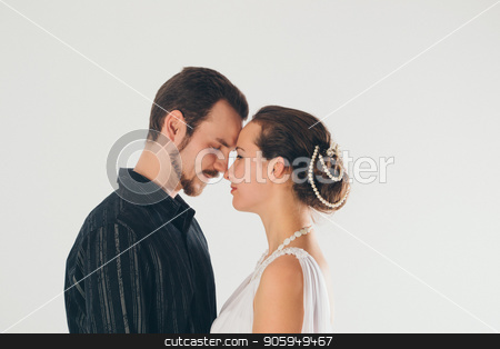 portrait: man and woman kissing on white background. The bride and groom in an isolated photo. Husband and wife face to face stock photo, portrait: man and woman kissing on white background. The bride and groom in an isolated photo. Husband and wife face to face by aaalll3110