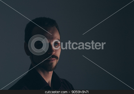 Face of handsome man with fashionable hairstyle half closed in shadow stock photo, Face of handsome man with fashionable hairstyle half closed in shadow by aaalll3110