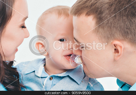 baby on the hands of parents on a white background. dad takes a mouth a pacifier from a baby stock photo, baby on the hands of parents on a white background. dad takes a mouth a pacifier from a baby by aaalll3110