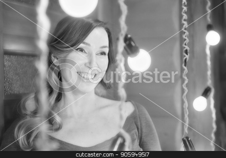 a pregnant woman on a lamps background stock photo, a pregnant woman on a lamps background by aaalll3110