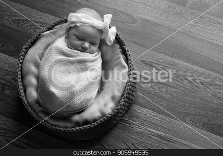 Portrait a little child in a cap lies on a basket. Face of newborn stock photo, Portrait a little child in a cap lies on a basket. Face of newborn by aaalll3110