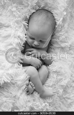 A little child in adiaper lies and sleeping stock photo, A little child in adiaper lies and sleeping by aaalll3110
