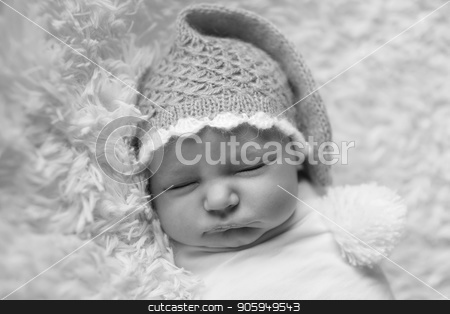 A little child in cap and in adiaper lies and sleeping stock photo, A little child in cap and in adiaper lies and sleeping by aaalll3110