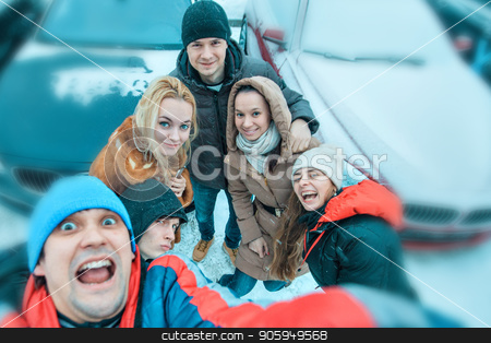 selfies of a group of young people in winter on the background of cars stock photo, selfies of a group of young people in winter on the background of cars by aaalll3110