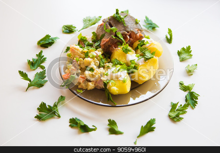 Boiled potatoes under sour cream, red fish, salad sprinkled with parsley on a plate of dark glass stock photo, Boiled potatoes under sour cream, red fish, salad sprinkled with parsley on a plate of dark glass by aaalll3110
