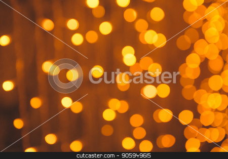 many blurred small electric bulbs on a wall. Yellow blurred lights. Wall of Christmas lights stock photo, many blurred small electric bulbs on a wall. Yellow blurred lights. Wall of Christmas lights by aaalll3110