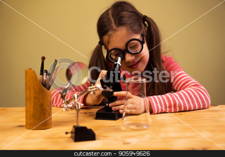 Little Girl Looking in Microscope. Child Education stock photo, Little Girl Looking in Microscope. Child Education Process by Gideon Ikigai