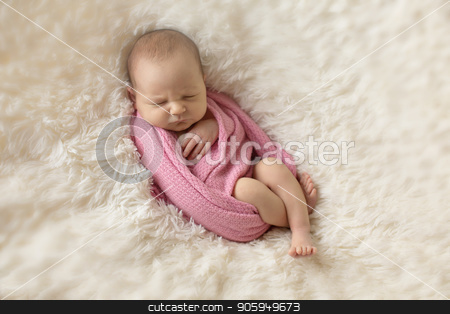 A little child in a pink diaper lies on a beige background stock photo, A little child in a pink diaper lies on a beige background by aaalll3110
