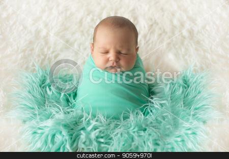 A little child in a greeen diaper lies on a beige background. Portrait of newborn stock photo, A little child in a greeen diaper lies on a beige background. Portrait of newborn by aaalll3110