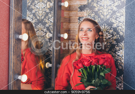 portrait of young beautiful blonde woman in red dress with red rose posing at mirror with her reflection stock photo, portrait of young beautiful blonde woman in red dress with red rose posing at mirror with her reflection by aaalll3110