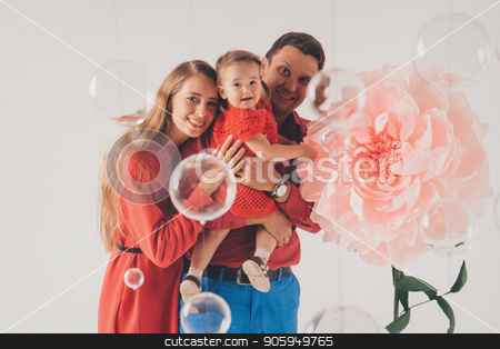 Big flower and little girl, woman and man in red on white background stock photo, Big flower and little girl, woman and man in red on white background by aaalll3110