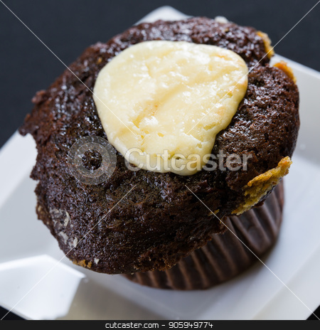 Close up shot of fresh bran muffin with icing stock photo, Close up shot of fresh bran muffin ready to be eaten by Shane Maritch