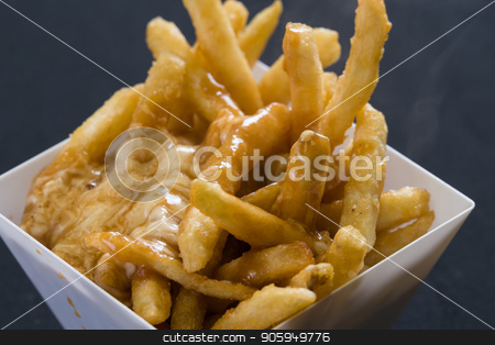 Close up shot of french fries stock photo, Close up shot of golden french fries by Shane Maritch