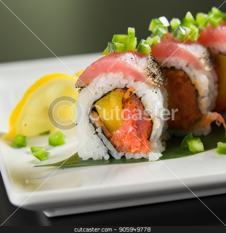 Sushi on a white plate stock photo, Close up of sushi on a white plate by Shane Maritch
