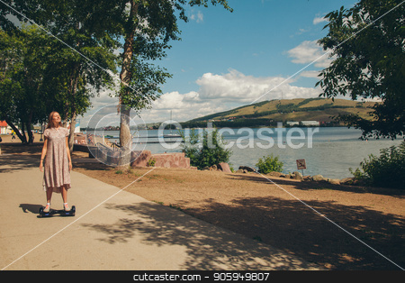 the girl on gyroscoter rides on the road stock photo, the girl on gyroscoter rides on the road by aaalll3110