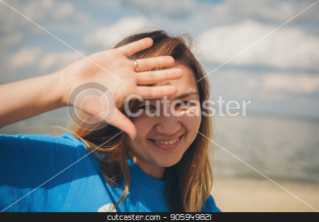 Portrait of woman on a sea background stock photo, Portrait of woman on a sea background by aaalll3110